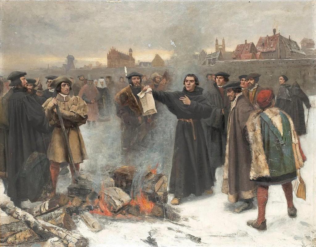 Lutero queima, em praça pública, a bula papal