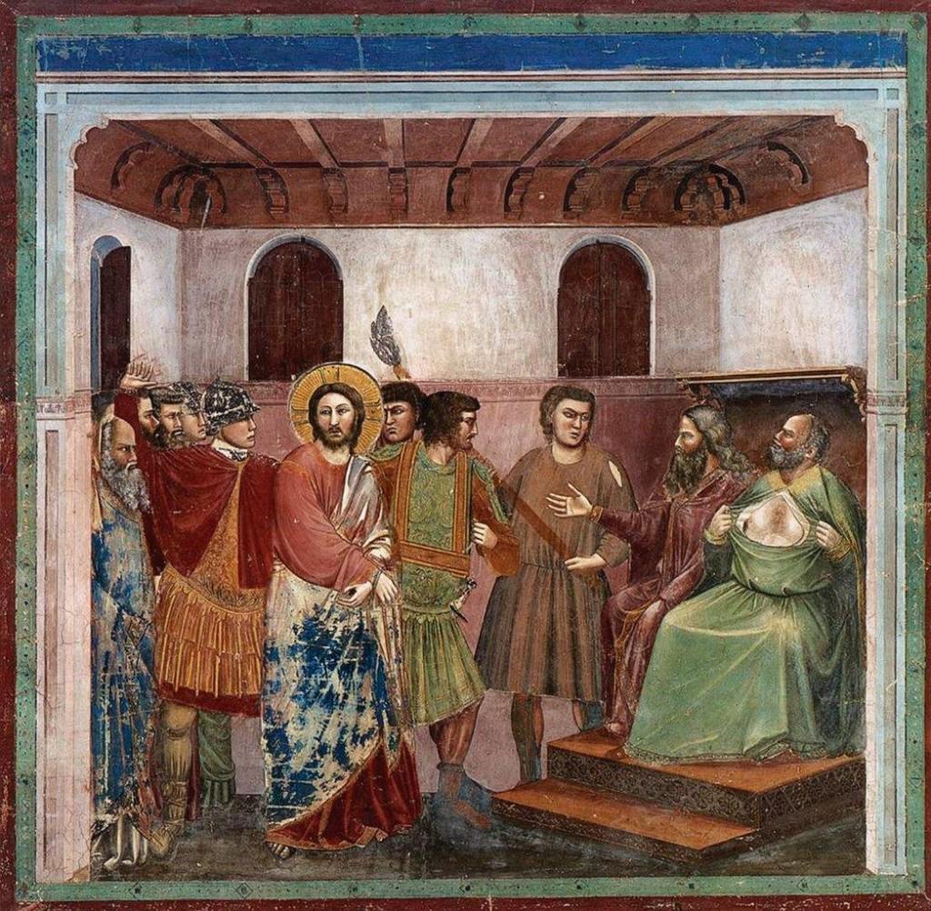 Anás e Caifás, sentados, montam uma farsa de julgamento para condenar Jesus Cristo, de pé com as mãos atadas. Afresco da Capela degli Scrovegni em Pádua (Itália). Pintado entre 1304 e 1306 pelo célebre artista italiano da época medieval Giotto di Bondone (1267 - 1337).